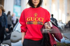 Yoyo Cao poses wearing a Gucci sweater after the Sacai show at the Palais de Tokyo during Paris Fashion Week Womenswear SS17 on October 3, 2016 in Paris, France.