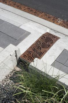 Nice to see the Iron Age Grates (www.ironagegrates.com).  Concrete Banding.  Nice paving leading into a bioswale.  And where is this?  Wait for it.  Kitchener.  Nice work IBI group and downtown Kitchener.