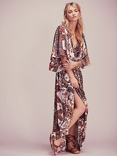 Printed Fern Maxi Party Dress | Beautifully sweeping maxi dress featuring V-neckline and flutter sleeves. Waist tie detailing and full skirted silhouette for a dramatic effect.