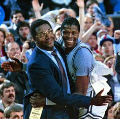 Georgetown's head coach John Thompson hugs Patrick Ewing after the Hoyas defeated Houston 84-75 to win the NCAA National Championship on April 2, 1984 in Seattle. 30 years ago today, Thompson became the first black coach to win the NCAA basketball tournament and Ewing was named the tournament's Most Outstanding Player.  (Georgetown University/Collegiate Images/Getty Images)