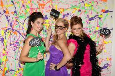 80s themed photobooth - the backdrop is awesome. I always wanted my room painted like that as a kid.