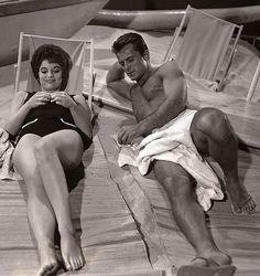1961: Robert Conrad & Karyn Kupcinet on a Warner Brothers soundstage beach shooting Hawaiian Eye (1959-1963, ABC)