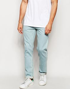 "Slim jeans by ASOS Stretch denim Light wash Five pockets Slim fit - cut closely to the body Machine wash 99% Cotton, 1% Elastane Our model wears a 32""/81 cm regular and is 185.5cm/6'1"" tall"