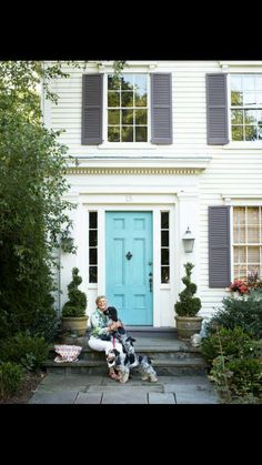 Playful color combination of turquoise door with purple-gray shutters on a very traditional white house. White Siding House, Yellow House Exterior, White Brick Houses, House Shutters, Yellow Houses, House Paint Exterior, Exterior Doors, House Shutter Colors, Front Door Paint Colors