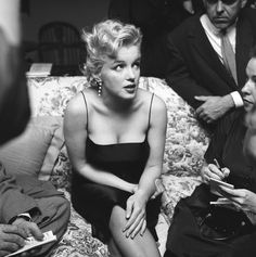 Roughly a year after her Connecticut stay, Marilyn Monroe hosting a press party at her home in Los Angeles, 1956.