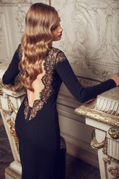 How much do we love this? Let us count the ways: open back, beautiful detail on the dress, silky waves, classic makeup - Game Over! #supasistalatina #latina Work it, girl!!