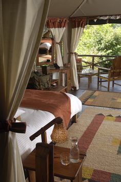 This uniquely situated luxury camp on the banks of the Talek River overlooks the mottled plains of the Maasai Mara, Kenya. This is your traditional safari experience. Luxury Glamping, Luxury Tents, Cabana, British Colonial Decor, Tent Living, Safari Decorations, Campaign Furniture, Tent Camping, Interior Design