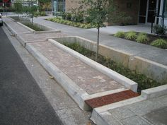 Sidewalk bioswale treats street runoff in Portland, OR