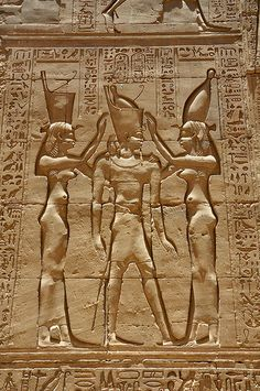 "Hoise the Protector says ""Horus wore the crowns of the North and the South, here he is at the Edfu Temple of Horus, being blessed by two Goddesses, one wearing the crown of the North, the other of the South!"""