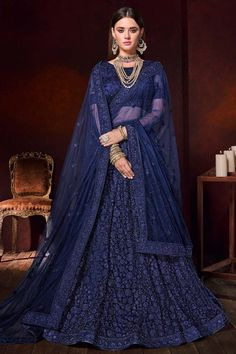 Dark Blue net semi stitch lehenga with net choli. This lehenga choli is embellished with stone, beads, sequins and dori work. Product are available in 32 to 58 sizes. It is perfect for Party Wear, Wedding Wear, Guest of Wedding Wear. Floral Lehenga, Net Lehenga, Lehenga Choli Online, Indian Bridal Lehenga, Indian Bridal Outfits, Indian Dresses, Indian Clothes, Lehenga Choli Designs, Haute Couture