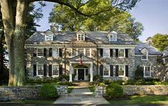Tumblr...Complete dream of a stacked stone Georgian revival style home in Moorestown, New Jersey, complete with matching retaining walls. Gorgeous 12-over-12 windows dressed with black shutters, third floor dormers, matching black door with sidelights and fanlight surrounded by classical style portico, and a lovely winding wing off to the right...