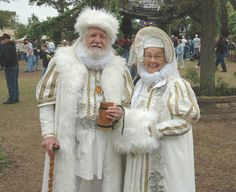 Love this old-world style Santa robe, love the beautiful white color, and old-fashioned charm of an older suit for Mr.& Mrs. Claus.