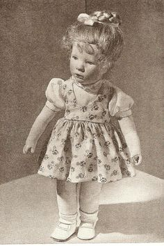 """Promotional image of a cloth Käthe Kruse doll exhibited in the German Democratic Republic, East Germany, 1958, photographer unknown. Interestingly the doll was labelled as being made by a """"Käte Kruse,"""" leading one to believe it might have been a """"type"""" doll made in the former factories of the Kruse company that were operational before the division of Germany. The Kruse family settled in West Germany, but much of the trained staff and machinery remained behind in the communist East."""
