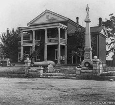 This is a VERY old image of the Courthouse and Confederate Monument in Martinsville, VA. (Note the unpaved roadway!)