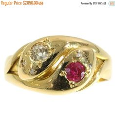 One of a kind antique ring crafted c.1890 in 18k rose gold with two intertwined snakes set with ruby and diamonds, certified as Victorian jewelry in excellent condition. Diamonds: One old European cut diamond with an estimated weight of 0.16 carat and four senailles used for the eyes. Precious stones: one ruby Dimensions: width on top 1,03 cm (0,41 inch) Ring Size US 6¾ (Free re-sizing) Video available at https://www.youtube.com/watch?v=WgV40z1pp98 Ref.13323-0105 See...