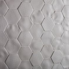 Look closely at these tiny glazed porcelain monochrome tiles and you'll see intricate works of art on each one. Each tile features subtle patterns which combine to stunning effect. Available in four different delicate designs, in sizes 130x114mm and 450x200 hexagons, plus a plain colour 150x500 co-ordinating tile, Selene is a collection that demands attention.