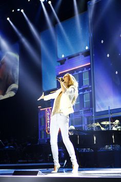 Celine Dion performs at Walmart Shareholders' Meeting 2012 by Walmart Stores, via Flickr. such a badass <3 her