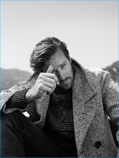 Kurt Iswarienko photographs Armie Hammer in a herringbone Burberry coat, Brunello Cucinelli flecked sweater, and J Brand jeans.