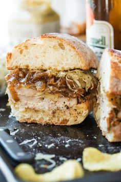 Pork Tenderloin Sandwich with Beer-Braised Onions, Sauerkraut and Swiss Cheese | thecozyapron.com