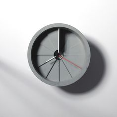 Concrete Wall Clock by 22 Design Studio is like a spiral staircase.