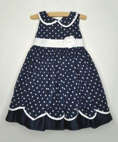 This Navy Polka Dot Rosette Dress - Infant, Toddler & Girls by Princess Faith is perfect! #zulilyfinds