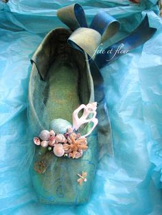 Decorated with ribbon, tulle, and tiny seashells, this beautiful ballet shoe is called the Little Mermaid Slipper. (Although I didn't think that mermaid had feet...)