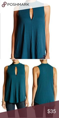"""NWT FREE PEOPLE RIBBED TANK NWT. Size XS can easily fit a size small too as this is a loose fit. Awesome turquoise color. mock neck offsets the keyhole cutout front on a ribbed peek-a-boo sleeveless tank. 26"""" length Free People Tops Tank Tops"""