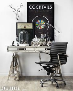 For a makeshift bar, layer a sleek array of spirits and barware atop an industrial-inspired desk.
