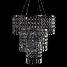 This refined chandelier is bedecked with large diamond cut crystals, perfect for setting your space ablaze with light. The diameter is 10.5 inches and the length is 11 inches. A 21 inch chain is in...