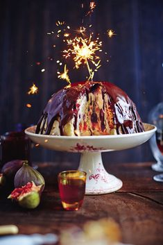 Think of this winter bombe recipe from Jamie Oliver's Christmas Cookbook as an alternative chocolate Christmas pudding, stuffed with fruit and ice cream. Winter Desserts, 13 Desserts, Pistachio Recipes, Fruit Recipes, Dessert Recipes, Recipes Dinner, Cake Recipes, Chocolate Christmas Pudding, Hot Chocolate