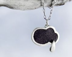 concrete and sterling silver rain cloud necklace... Interesting