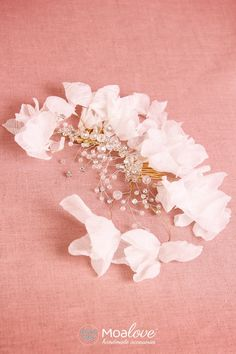 http://www.moalove.pl/en/hair-adornments/product/39/bela-silk-floral-headpieces-with-crystal-and-bedas/