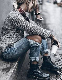 Tattered boyriend jeans, punk inspired shoes and a loose sweater/top. Lose the scarf. add cool accessories or none at all