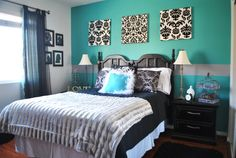 Turquoise and Black Guest Bedroom. I made the curtains, silhouettes, and spray painted my parent's old bedroom furniture. The lamps are hand me downs. Accents are from Home Goods. Spent about $150 on the whole room.
