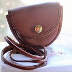 "Auth. Coach Leather Belt Bag cute! Auth Coach British Tan leather Belt Bag, cute! Has approx. 1"" cut or son on front left, by trim. Not a huge deal, but would like to be upfront!  British tan leather, solid brass hardware. Vintage style!  Non-smoking home. Coach Bags"