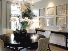 Love the white orchids on the table, and the palm tree in the corner!