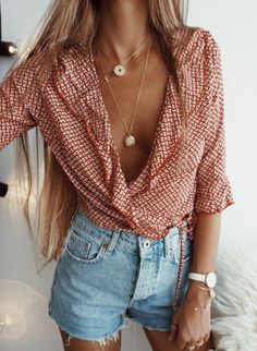 Love the cut of the top and the frilly edges. Light attire and the picnic cloth ties it in to make it look well worn and casual