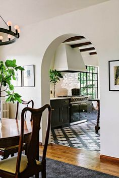 Love the arched entryway into this kitchen.