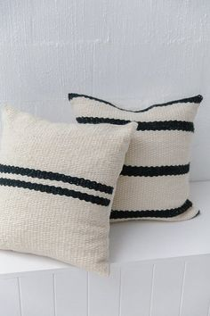"""Size: 50 x 50 cm   approx. 1'8"""" x 1'8""""    colour: natural white + black    fibre: argentinian sheep's wool    construction: hand woven cushion + enviro friendly insert    origin: argentina    made by: porteño weavers    description    the porteño collection has travelled from urban buenos aires where immigrant women from rural south america come together to form weaving collectives. inspired by the multiculturalism and flow of ideas in argentina's biggest city they often incorporate more…"""