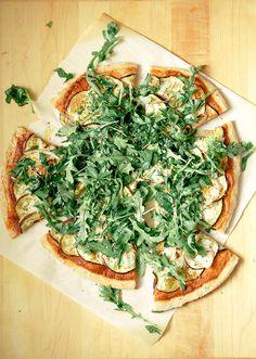 // crispy eggplant + harissa flatbread with greens