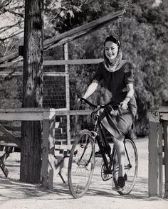 Olivia de Havilland rides a bike. Happy 99th!