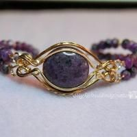 Looking for jewelry project inspiration? Check out Fancy Band - Wire Wrapped Prong Ring by member Bobbi Maw.