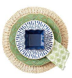 """Darius Gold"" accent plate, Lenox; ""Hunting"" dinner plate, Bordallo Pinheiro; ""Straw Loop"" placemat and ""Pistachio Medallion"" napkin, Juliska; cobalt ramekin, Prima Design. - Photo: Peter Krumhardt"