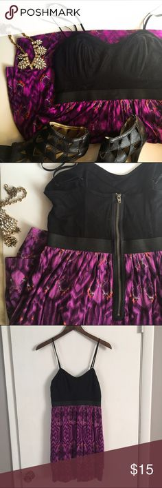 Elle boho print purple dress Soft and comfortable dress. The bottom is has a girly feel but the exposed zipper and bra like top give an edgy feel. The straps are adjustable. Elle Dresses Mini