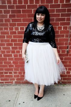 this outfit makes me die a little. I need a tulle skirt, glittery sequined top and pointy, little kitten heels stat. OOOOH! and pearls!