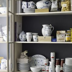 Beautiful kitchen cabinet with mixed dinnerware in the 2012 Royal Copenhagen Catalogue