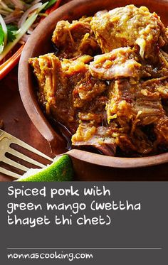 Spiced pork with green mango (wettha thayet thi chet) | Appearing widely in our research for this dish, the following rhyme is a neat summary of Burmese cookery: 'Of all the fruit, the mango is best; of all the meat, pork is best; and of all the leaves, lahpet's (fermented tea leaf) the best.' Mango is used in this pork curry to add flavour and to help tenderise the meat, while shredded green mango also makes a piquant accompaniment as a salad. Often flavoured with ground dried shrimp…