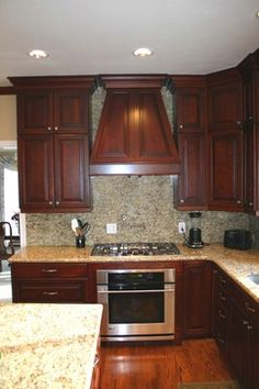 LOVE THIS ONE! All parts - counter, cabinets, floor colors. And I don't think its too dark