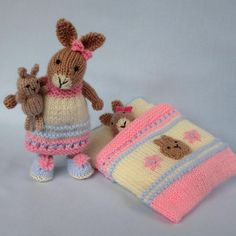 Little girls will love this cute little bunny who is wearing a pretty nightdress and slippers. She has a cosy sleeping bag with an attached pillow and a tiny toy bunny to cuddle while she sleeps.Bedtime bunny plus tiny toy bunny and sleeping bag - kn Knitting Yarn, Baby Knitting, Knitting Patterns, Doll Patterns, Crochet Patterns, Bunny Toys, Baby Bunnies, Bead Crochet, Crochet Toys