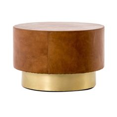 Details add depth to a deceptively simple shape. Hand-stitched copper leather offsets a bright brass base with rivet detail for a striking material mix and mid-century spirit. Perfect in pairs as the new alternative to the traditional coffee table. Leather Coffee Table, Coffee Table Styling, Cool Coffee Tables, Leather Ottoman, Round Coffee Table, Gold Accent Table, Gold Table, Accent Tables, Gold Furniture
